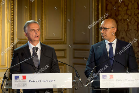 Swiss Federal Councillor Didier Burkhalter, left, and French State Secretary for European Affairs Harlem Desir during a signing ceremony of an agreement on tax system for EuroAirport Basel Mulhouse Freiburg in Paris