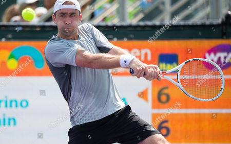 Benjamin Becker, of Germany, plays a backhand against, Adrian Mannarino, of France, during a match at the Miami Open presented by Itau professional tennis tournament, played at Crandon Park Tennis Center in Key Biscayne, Florida, USA