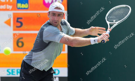 Stock Picture of Benjamin Becker, of Germany, plays a backhand against, Adrian Mannarino, of France, during a match at the Miami Open presented by Itau professional tennis tournament, played at Crandon Park Tennis Center in Key Biscayne, Florida, USA
