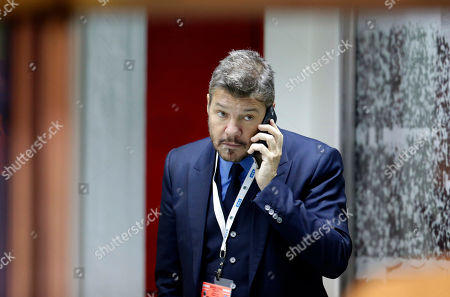 Stock Picture of TV host, media producer and businessman Marcelo Tinelli speaks on the phone before a 2018 Russia World Cup qualifying soccer match between Argentina and Chile at the Monumental stadium in Buenos Aires, Argentina