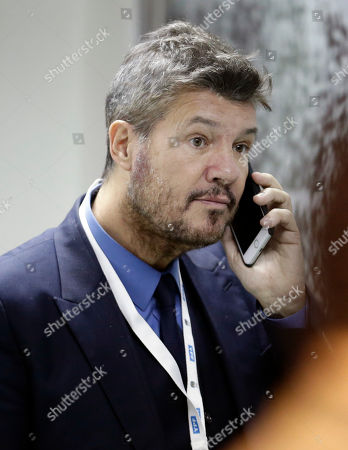 TV host, media producer and businessman Marcelo Tinelli speaks on the phone before a 2018 Russia World Cup qualifying soccer match between Argentina and Chile at the Monumental stadium in Buenos Aires, Argentina