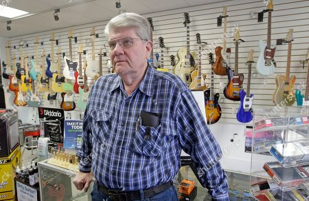 Mike Murphy, owner of Murphy's Guitars, speaks to reporters about Kurt W. Cochran and his wife, Melissa Cochran, in Bountiful, Utah. Kurt W. Cochran was killed and his wife, Melissa Cochran, was among dozens who were injured in Wednesday's London attack according to a statement issued Thursday by the family through a Mormon church spokesman