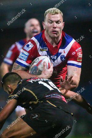 Wakefield's Keegan Hirst is tackled by Leigh's Eloi Pelissier.