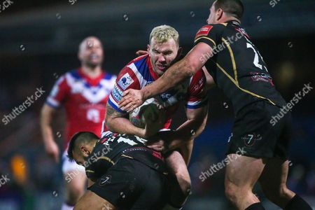 Wakefield's Keegan Hirst is tackled by Leigh's Eloi Pelissier and Sam Hopkins.