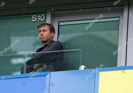 Chelsea owner Roman Abramovic stands up, to watch the match, in his private box