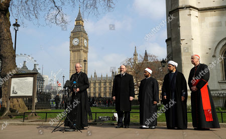 The Archbishop of Canterbury, Justin Welby, left, speaks during a gathering of faith leaders take part in a vigil outside Westminster Abbey for the victims of Wednesday's attack in London, . Others are from left: Chief Rabbi Ephriam Mirvis, Sheikh Ezzat Khalifa, Sheikh Mohammad al Hilli and Cardinal Vincent Nichols, Archbishop of Westminster