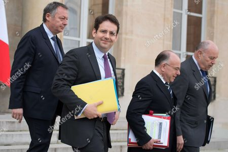 From left, New French Interior Minister Matthias Fekl, French Junior Sport Minister Thierry Braillard, French Prime Minister Bernard Cazeneuve and French minister for Town and Country planning, rural affairs and local authorities Jean-Michel Baylet leave the Elysee Presidential Palace after the weekly cabinet meeting