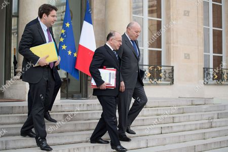 From left, New French Interior Minister Matthias Fekl, French Prime Minister Bernard Cazeneuve and French minister for Town and Country planning, rural affairs and local authorities Jean-Michel Baylet leave the Elysee Presidential Palace after the weekly cabinet meeting