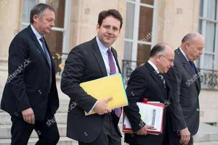 New French Interior Minister Matthias Fekl, French Junior Sport Minister Thierry Braillard, French Prime Minister Bernard Cazeneuve and French minister for Town and Country planning, rural affairs and local authorities Jean-Michel Baylet leave the Elysee Presidential Palace after the weekly cabinet meeting