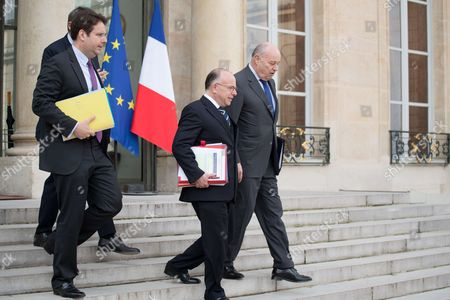 New French Interior Minister Matthias Fekl, French Prime Minister Bernard Cazeneuve and French minister for Town and Country planning, rural affairs and local authorities Jean-Michel Baylet leave the Elysee Presidential Palace after the weekly cabinet meeting