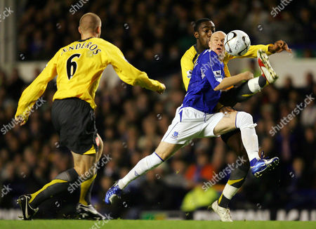 Andy Johnson of Everton battles with Johann Djourou and Philippe Senderos of Arsenal