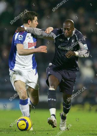 Bolton Wanderers'  Khalilou Fadiga pushes Blackburn Rovers'  Brett Emerton away from the ball