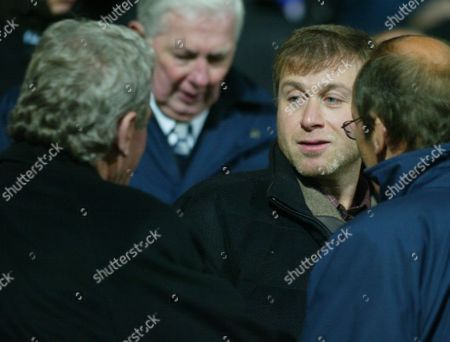 Chelsea owner, Roman Abramovic shakes hands with Portsmouth chairman, Milan Manderic.
