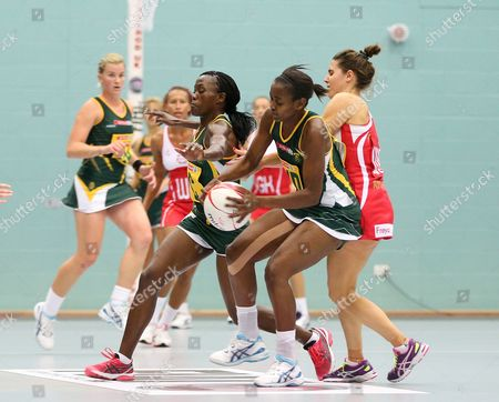 Bongiwe Msomi and Precious Mthembu of South Africa and Mia Ritchie of England Netball in action