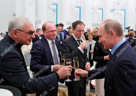 Stock Picture of Russian President Vladimir Putin, right, toasts at an award ceremony for winners of the 2016 Presidential Prize for Children's Art and Literature in the Kremlin in Moscow, Russia, . From left, Mosfilm director Karen Shakhnazarov, presidential cultural adviser Vladimir Tolstoy and Culture Minister Vladimir Medinsky