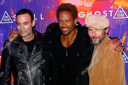 Stock Image of Anthony Delon, Gary Dourdan and Sagamore Stevenin, from left to right, pose during a photocall for the french premiere of 'Ghost in the Shell' in Paris