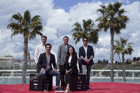Spanish film maker Luis Oliveros (C) poses with cast members Andres Gertrudix (L), Marc Clotet (2L), Melina Matthews (2R) and Alejo Sauras (R) during the presentation of the film 'El jugador de ajedrez' ('The chess player') on the ocasison of the 20th edition of Malaga Film Festival in Malaga, Spain, 24 March 2017.