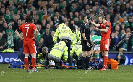 Gareth Bale of Wales talks to referee Nicola Rizzoli.