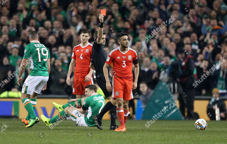 Neil Taylor of Wales is given a red card by referee Nicola Rizzoli for his tackle on Seamus Coleman of Ireland.