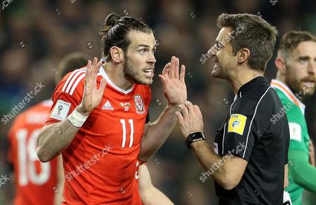 Gareth Bale of Wales speaks to referee Nicola Rizzoli.