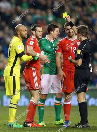 Gareth Bale of Wales is given a yellow card by referee Nicola Rizzoli.