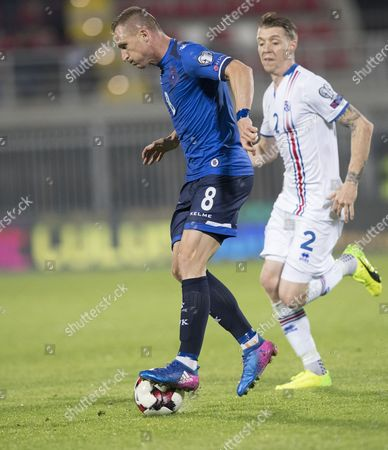 Birkir Mar Saevarsson (L) of Iceland in action against Besart Berisha (R) of Kodovo during the FIFA World Cup 2018 qualifying soccer match between Kosovo and Iceland in Shkoder, Albania, 24 March 2017.