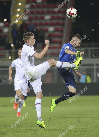 Birkir Mar Saevarsson (R) of Iceland in action against Valon Berisha of Kodovo during the FIFA World Cup 2018 qualifying soccer match between Kosovo and Iceland in Shkoder, Albania, 24 March 2017.