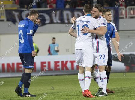Bjorn Bergmann Sigurdarson (C-R) and Gylfi Thor Sigurdsson (center-L) of Iceland celebrate the first goal against Kosovo during the FIFA World Cup 2018 qualifying soccer match between Kosovo and Croatia in Shkoder, Albania, 24 March 2017.