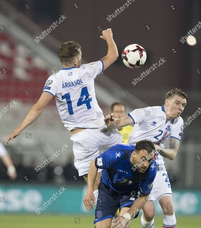 Kari Arnason (L) and Birkir Mar Saevarsson (R) of Iceland in action against Atdhe Nuhiu of Kodovo (C) during the FIFA World Cup 2018 qualifying soccer match between Kosovo and Iceland in Shkoder, Albania, 24 March 2017.