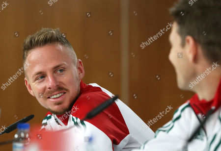 Hungary's Balazs Dzsudzsak looks at teammate Zoltan Gera, right, during a news conference at Lisbon's Luz stadium . Hungary will play Portugal in a 2018 Russia World Cup Group B qualifying soccer match Saturday