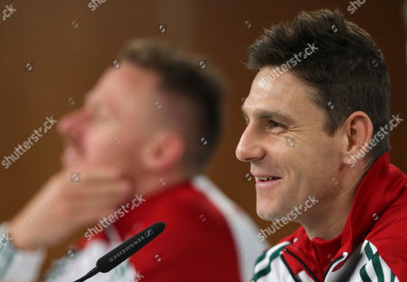 Hungary's Zoltan Gera smiles during a news conference with teammate Balazs Dzsudzsak, left, at Lisbon's Luz stadium . Hungary will play Portugal in a 2018 Russia World Cup Group B qualifying soccer match Saturday
