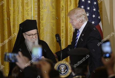 United States President Donald Trump acknowledges Archbishop Demetrios of America of the Greek Orthodox Archdiocese of America during an event to celebrate Greek Independence Day in the East Room the White House
