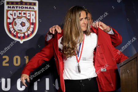 Brandi Chastain, Tony DiCicco Brandi Chastain puts on a jacket with the help of former coach Tony DiCicco during an induction ceremony for the National Soccer Hall of Fame, in San Jose, Calif