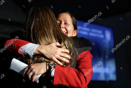 Shannon MacMillan, Brandi Chastain Shannon MacMillan, right, hugs fellow inductee Brandi Chastain during an induction ceremony for the National Soccer Hall of Fame, in San Jose, Calif