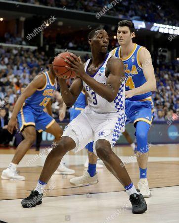 Edrice Adebayo, Gyorgy Goloman Kentucky forward Edrice Adebayo (3) plays against UCLA forward Gyorgy Goloman (14) in the first half of an NCAA college basketball tournament South Regional semifinal game, in Memphis, Tenn