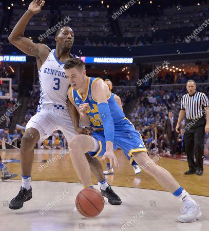 UCLA forward TJ Leaf drives on Kentucky forward Edrice Adebayo in the first half of an NCAA college basketball tournament South Regional semifinal game, in Memphis, Tenn
