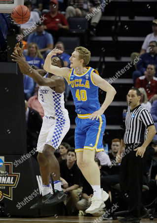 UCLA center Thomas Welsh and Kentucky forward Edrice Adebayo vise for a loose ball in the first half of an NCAA college basketball tournament South Regional semifinal game, in Memphis, Tenn