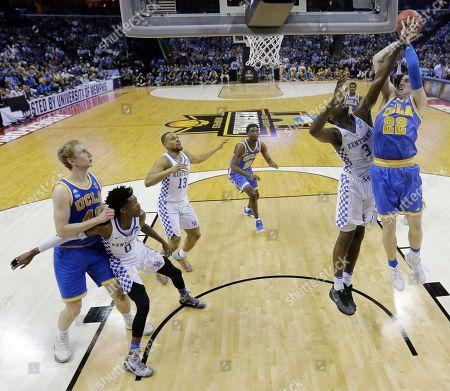 UCLA forward TJ Leaf shoots against Kentucky forward Edrice Adebayo in the first half of an NCAA college basketball tournament South Regional semifinal game, in Memphis, Tenn