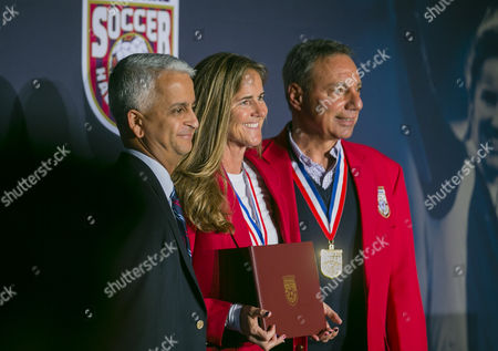 Brandi Chastain, Tony DiCicco, and Sunil Gulatia pose for a picture during the induction ceremony for the National Soccer Hall of Fame - Class of 2016 Induction prior to the FIFA World Cup Qualifying game between the United States and Honduras at Avaya Stadium in San Jose, CA. The US defeated Honduras 6-0