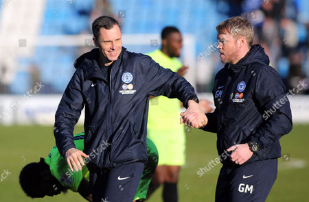 Peterborough United Manager Grant McCann shakes hands with Head of Coaching Dave Farrell