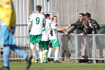 Stock Image of Bognor Regis Town midfielder James Fraser scores a goal 1-0 and celebrates during Regis Town and Canvey Island at Nyewood Lane, Bognor