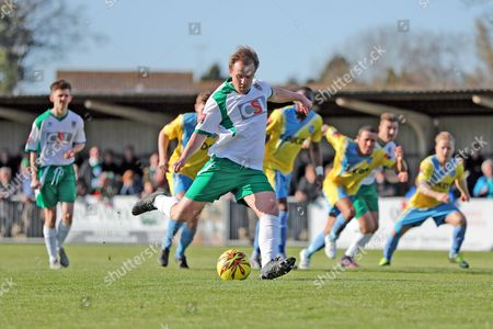 Bognor Regis Town midfielder James Fraser takes a penalty and scores a goal 2-0 during the Ryman Premier League match between Bognor Regis Town and Canvey Island at Nyewood Lane, Bognor