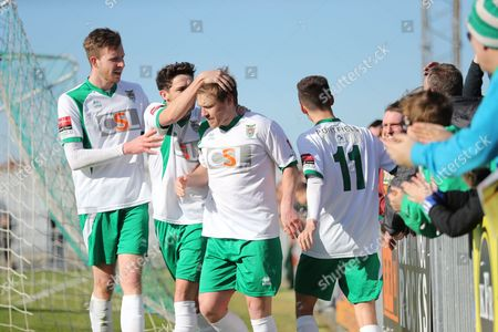 Bognor Regis Town midfielder James Fraser takes a penalty and scores a goal 2-0 and celebrates  during the Ryman Premier League match between Bognor Regis Town and Canvey Island at Nyewood Lane, Bognor