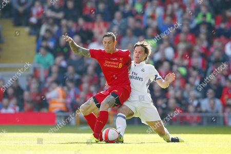 Daniel Agger competes with Fernando Morientes during the LFC Foundation Charity match between Liverpool Legends and Real Madrid Leyendas played at Anfield, Liverpool, on 25th March 2017