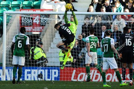 Hibs goalie Ross Laidlaw denies John Baird during the Ladbrokes Scottish Championship match between Hibernian and Falkirk at Easter Road, Edinburgh