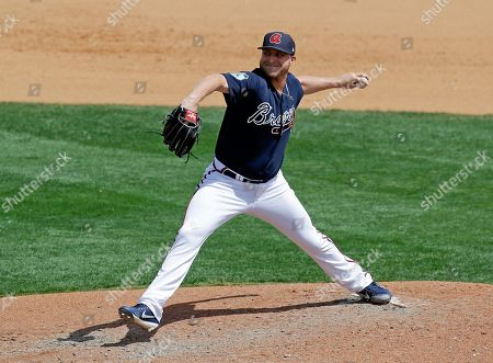 Atlanta Braves' Kevin Chapman pitches against the New York Mets in the seventh inning of a spring training baseball game, in Kissimmee, Fla