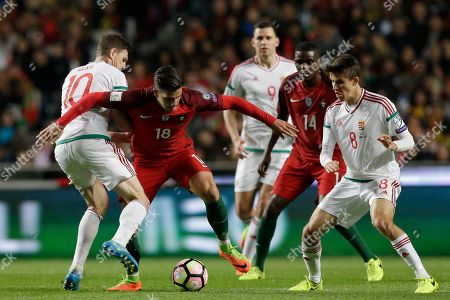 Zoltan Gera, Andre Silva, Adam Nagy, William Carvalho, Adam Szalai Hungary's Zoltan Gera, left, duels for the ball with Portugal's Andre Silva, second left, in presence of Hungary's Adam Nagy, right, Portugal's William Carvalho, second right, and Hungary's Adam Szalai, center back, during the World Cup Group B qualifying soccer match between Portugal and Hungary at the Luz stadium in Lisbon