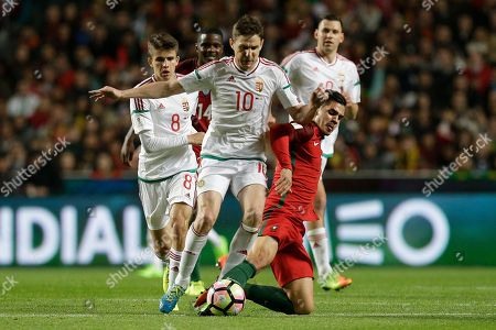 Zoltan Gera, Andre Silva Hungary's Zoltan Gera, center left, duels for the ball with Portugal's Andre Silva, center right, during the World Cup Group B qualifying soccer match between Portugal and Hungary at the Luz stadium in Lisbon