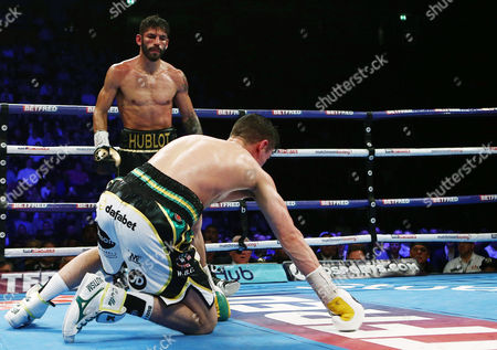 Jorge Linares stands over Anthony Crolla during the WBA WBC Diamond and Ring Magazine Lightweight World Championship fight at the MEN Arena, Manchester, on 25th March 2017