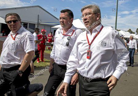 (L-R) McLaren-Honda racing director Eric Boullier (L), McLaren CEO Zak Brown, and Ross Brawn, Formula One Group's Managing Director of Motorsports, walk through the paddock prior the 2017 Formula One Grand Prix of Australia at the Albert Park circuit in Melbourne, Australia, 26 March 2017.